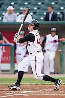 Kevin Patterson (45) of the Lansing Lugnuts follows through on his swing against the Fort Wayne TinCaps at Cooley Law School Stadium on June 5, 2013 in Lansing, Michigan.  The TinCaps defeated the Lugnuts 8-5.  (Brian Westerholt/Four Seam Images)