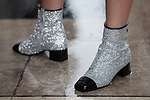 Street Style during Paris Fashion Week Spring Summer 2018 on Sunday 1st October 2017. Image shows a pair of black tip silver glitter and sparkle effect ankle boots by Chanel. (Photo by JSTREETSTYLE/AFLO)