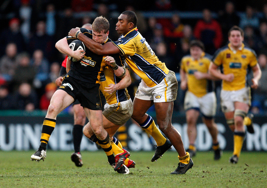Photo: Richard Lane..London Wasps v Leeds Carnegie. Guinness Premiership. 05/01/2008..Wasps' Tom Rees is tackled by Leeds' Apolosi Satala.