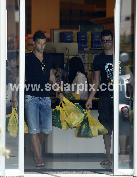 **ALL-ROUND PICTURES FROM SOLARPIX.COM**.**WORLD SYNDICATION RIGHTS EXCEPT BELGIUM, GERMANY, HOLLAND, SCANDINAVIA, SOUTH AMERICA, SPAIN, & USA**.The portuguese footballer Simao Sabrosa shopping in a supermarket in Madrid during his day off from training with Atletico de Madrid, who he has been playing for since 2007. Madrid, Spain. 15 July 2009..This pic: Simao Sabrosa..JOB REF: 9672 SKX      DATE:  15_07_2009.**MUST CREDIT SOLARPIX.COM OR DOUBLE FEE WILL BE CHARGED**.**MUST NOTIFY SOLARPIX OF ONLINE USAGE**.**CALL US ON: +34 952 811 768 or LOW RATE FROM UK 0844 617 7637**