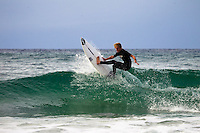 Gene Thompson surfing on a small but fun day at Burleigh Point, Gold Coast, Australia
