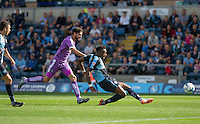 Gozie Ugwu of Wycombe Wanderers fires a shot at goal under pressure from Kelvin Mellor of Plymouth Argyle during the Sky Bet League 2 match between Wycombe Wanderers and Plymouth Argyle at Adams Park, High Wycombe, England on 12 September 2015. Photo by Andy Rowland.