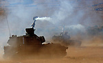 An Israeli army 155mm mobile artillery fires into southern Lebanon, from a position on the Israeli-Lebanese border August 6, 2006. Hizbollah killed 11 Israeli soldiers on Sunday in its deadliest rocket strike yet and Israeli bombs killed 18 Lebanese civilians as Lebanon rejected a draft U.N. resolution to end the 26-day-old war JINI/ANCHO GOSH/EPA