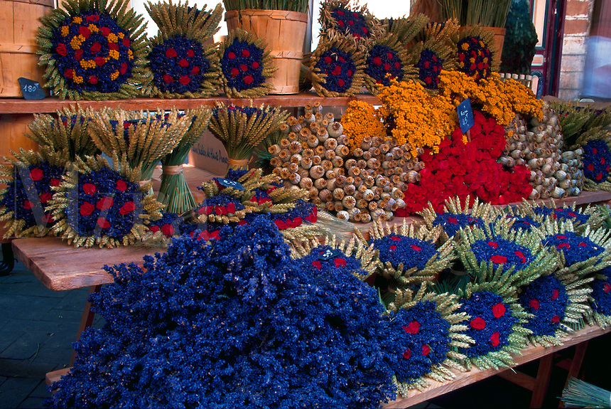 A display of flowers, wheat sheaves and lavender on display in a French open air market. France.