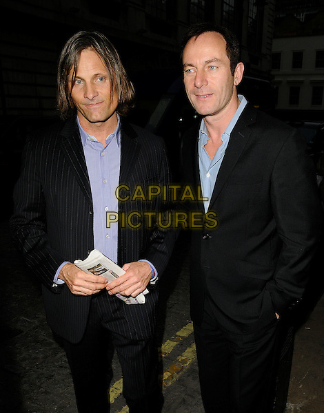 "VIGGO MORTENSEN & JASON ISAACS .At the ""Good"" Screening and Q & A session, Curzon Mayfair cinema, London, England, UK, March 30th 2009..half length black suit pinstripe grey gray purple shirt long hair Q&A and blue hands in pockets newspaper .CAP/CAN.©Can Nguyen/Capital Pictures"