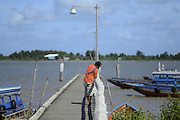 One of boat owner and driver passes his time while waiting customer and participating to the end of year 2010 party of fishermen at Leonsberg, located northern part of Paramaribo. ....End of year 2010 celebrations on the streets of Paramaribo. Suriname is one of biggest consumer in South America that using firecrackers, fireworks ( also locally known as pagara ) for celebrations, especially for end of every years and also beginning of every new Chinese Years.