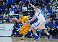 February 7, 2015 - Colorado Springs, Colorado, U.S. -  Wyoming guard, Riley Grabau #2, drives for the lane during an NCAA basketball game between the University of Wyoming Cowboys and the Air Force Academy Falcons at Clune Arena, U.S. Air Force Academy, Colorado Springs, Colorado.  Air Force soars to a 73-50 win over Wyoming.