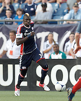 New England Revolution midfielder Saer Sene (39) dribbles down the wing. In a Major League Soccer (MLS) match, Toronto FC defeated New England Revolution, 1-0, at Gillette Stadium on July 14, 2012.