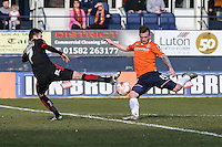 Jack Marriott of Luton Town (right) shoots under pressure from Gwion Edwards of Crawley Town (left) during the Sky Bet League 2 match between Luton Town and Crawley Town at Kenilworth Road, Luton, England on 12 March 2016. Photo by David Horn/PRiME Media Images.