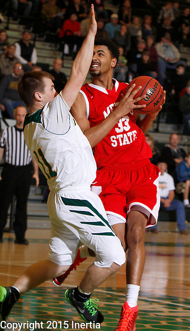 JANUARY 31, 2015 -- Obi Kyei #33 of Metro State drives on Wyatt Krogman #11 of Black Hills State during their Rocky Mountain Athletic Conference men's basketball game Saturday evening at the Donald E. Young Center in Spearfish, S.D.  (Photo by Dick Carlson/Inertia)