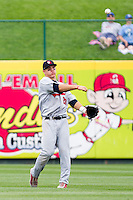 Mike Trout (23) of the Arkansas Travelers throws a ball back to the infield during a game against the Springfield Cardinals on May 10, 2011 at Hammons Field in Springfield, Missouri.  Photo By David Welker/Four Seam Images.