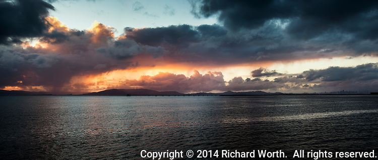 Months of drought finally broken by days of rain - then the clouds opened a bit for sunset magic.  After the magic, the clouds returned.  It started raining again.  San Francisco Bay.  Far right, the San Francisco skyline.
