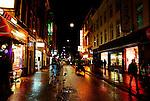 Downtown Amsterdam street at night.