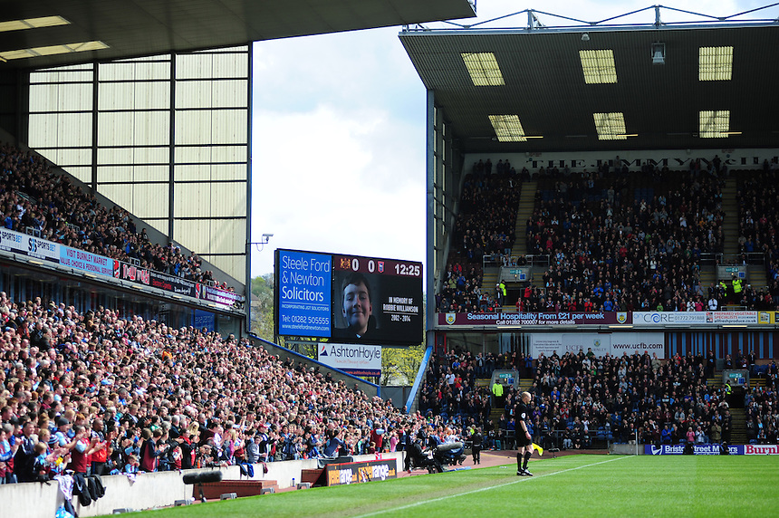 Burnley fans start a round of applause in member of Robbie Williamson who's picture is displayed on the big screen<br /> <br /> Photo by Chris Vaughan/CameraSport<br /> <br /> Football - The Football League Sky Bet Championship - Burnley v Ipswich Town - Saturday 26th April 2014 - Turf Moor - Burnley<br /> <br /> &copy; CameraSport - 43 Linden Ave. Countesthorpe. Leicester. England. LE8 5PG - Tel: +44 (0) 116 277 4147 - admin@camerasport.com - www.camerasport.com