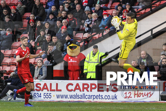 Liam Roberts (Walsall FC) leaps into the air to catch a shot during the Sky Bet League 1 match between Walsall and Sunderland at the Banks's Stadium, Walsall, England on 24 November 2018. Photo by James  Gill / PRiME Media Images.