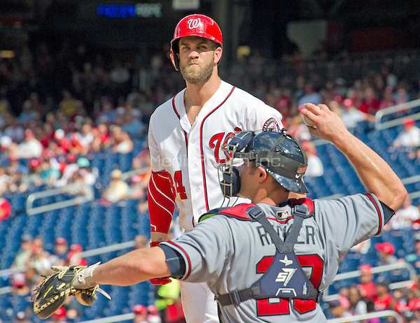Washington Nationals right fielder Bryce Harper (34) grimaces between pitches as he bats in the seventh inning against the Atlanta Braves at Nationals Park in Washington, D.C. on Sunday, August 14, 2016.  The Nationals won the game 9 - 1.<br /> Credit: Ron Sachs / CNP/MediaPunch ***FOR EDITORIAL USE ONLY***
