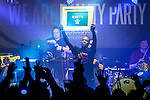 """© Joel Goodman - 07973 332324 . 11/04/2015 . Manchester , UK . KERMIT ( Paul Leveridge ) holds up a framed """" North """" . Black Grape perform a reunion gig in support of Bez's Reality Party at the Old Granada Studios Warehouse . Photo credit : Joel Goodman"""