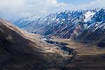 River flowing through mountain valley, Uchkul River, Ak-Shyirak Range, Sarychat-Ertash Strict Nature Reserve, Tien Shan Mountains, eastern Kyrgyzstan