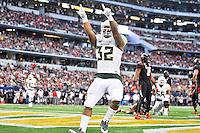 Baylor running back Shock Linwood (32) celebrates after scoring a touchdown during NCAA Football game, Saturday, November 29, 2014 in Arlington, Tex. (Mo Khursheed/TFV Media via AP Images)