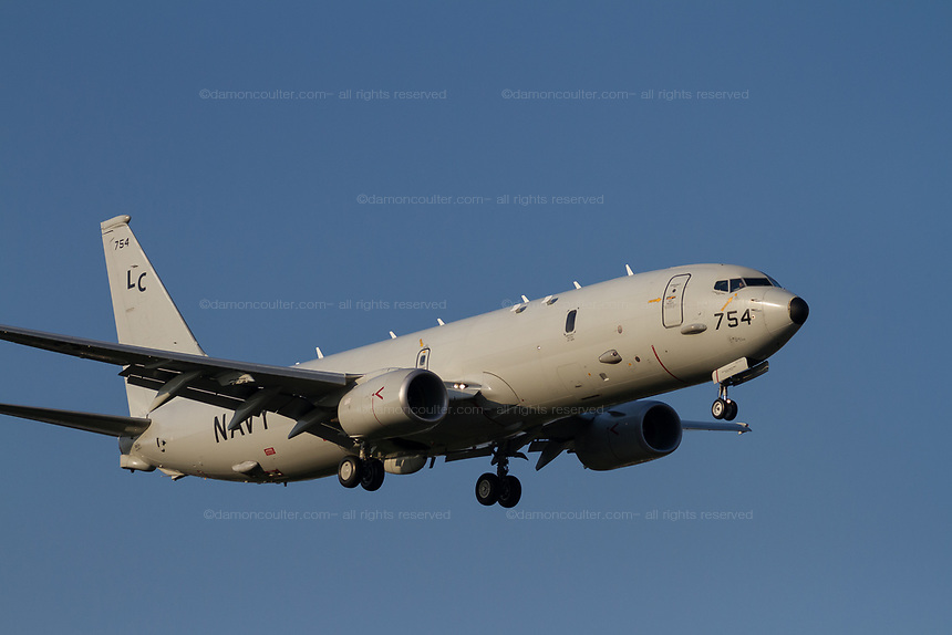 A Boeing P-8 Poseidon, multi-mission maritime aircraft, with the US Navy flying near Naval Air Facility, Atsugi,  Yamato, Kanagawa, Japan. Thursday April 25th 2019