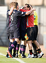 Partick's Kris Doolan (16) celebrates with manager Jackie McNamara after he scores Thistle's equaliser late into injury time ...