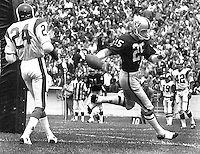 Raider Fred Biletnikorr scores TD against the Rams, #24 Clancy Williams..<br />