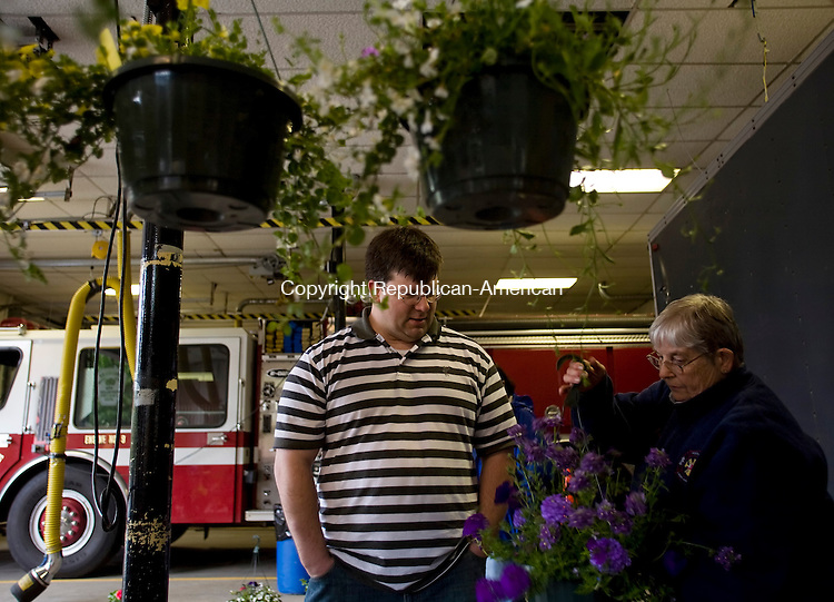 SOUTHBURY--9 May 2008--050908TJ05 - Dave Bochniak, from Southbury, gets help picking out a plant from Trudy Kelley, the secretary of the Ladies Auxiliary of the Southbury Volunteer Fireman's Association, at the auxiliary's annual plant sale on Friday, May 9, 2008. The sale continues on Saturday, begining at 9 a.m. and running until all of the plants are sold. (T.J. Kirkpatrick/Republican-American)