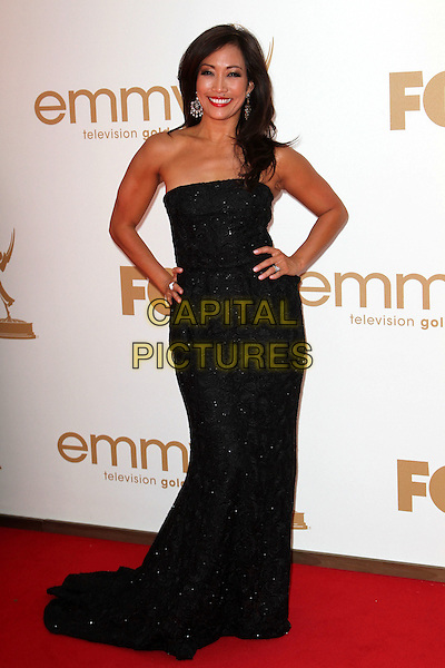 Carrie Ann Inaba.63rd Primetime Emmy Awards - Arrivals Held at The Nokia LA Live, Los Angeles, California, USA..September 18th, 2011.emmys full length black strapless dress hands on hips peplum.CAP/ADM/KB.©Kevan Brooks/AdMedia/Capital Pictures.