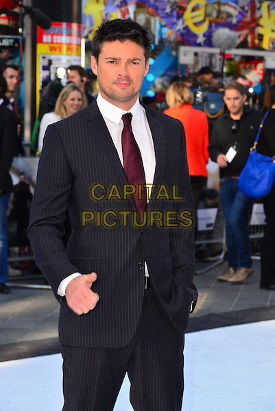 Karl Urban.attending the UK film premiere of 'Star Trek Into Darkness 3D' held at the Empire Cinema, London, United Kingdom, .2nd May 2013..half length grey gray pinstripe suit red maroon tie white shirt hand in pocket thumb up gesture .CAP/BF.©Bob Fidgeon/Capital Pictures
