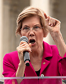 United States Senator Elizabeth Warren (Democrat of Massachusetts) speaks at the Anti-Kavanagh protest outside the the United States Supreme Court in Washington, DC as the US Senators continue their floor statements across the street inside the US Capitol on Saturday, October 6, 2018. <br /> Credit: Ron Sachs / CNP<br /> RESTRICTION: NO New York or New Jersey Newspapers or newspapers within a 75 mile radius of New York City)