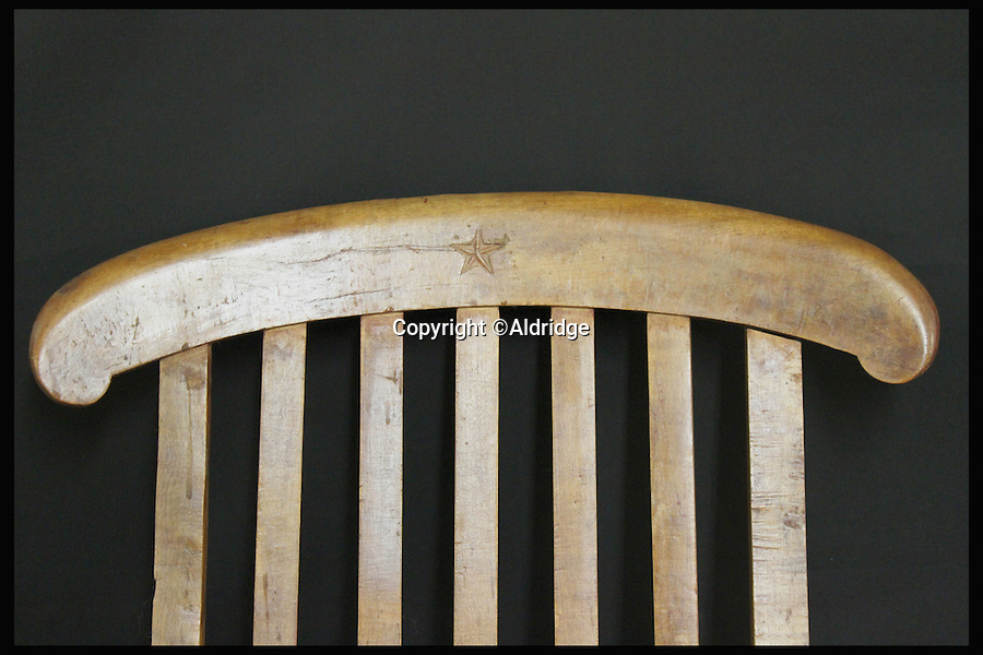 BNPS.co.uk (01202 558833)<br /> Pic: Aldridge/BNPS<br /> <br /> *Please use full byline*<br /> <br /> The deck chair's top.  Expected to sell for &pound;80,000.<br /> <br /> An incredibly rare deckchair that was recovered from the wreck site of the Titanic has surfaced for sale 103 years later.<br /> <br /> The collapsible chair graced the first class promenade deck of the luxury liner and was washed overboard when the ship sank after hitting an iceberg on its maiden voyage in 1912.<br /> <br /> The wooden item was found bobbing on the surface of the Atlantic by the crew of the Mackay-Bennett, the ship given the grim task of recovering the bodies of the victims in the wake of the tragedy.