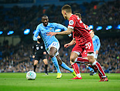 9th January 2018, Etihad Stadium, Manchester, England; Carabao Cup football, semi-final, 1st leg, Manchester City versus Bristol City; Yaya Toure of Manchester City closes in on Jamie Paterson of Bristol City