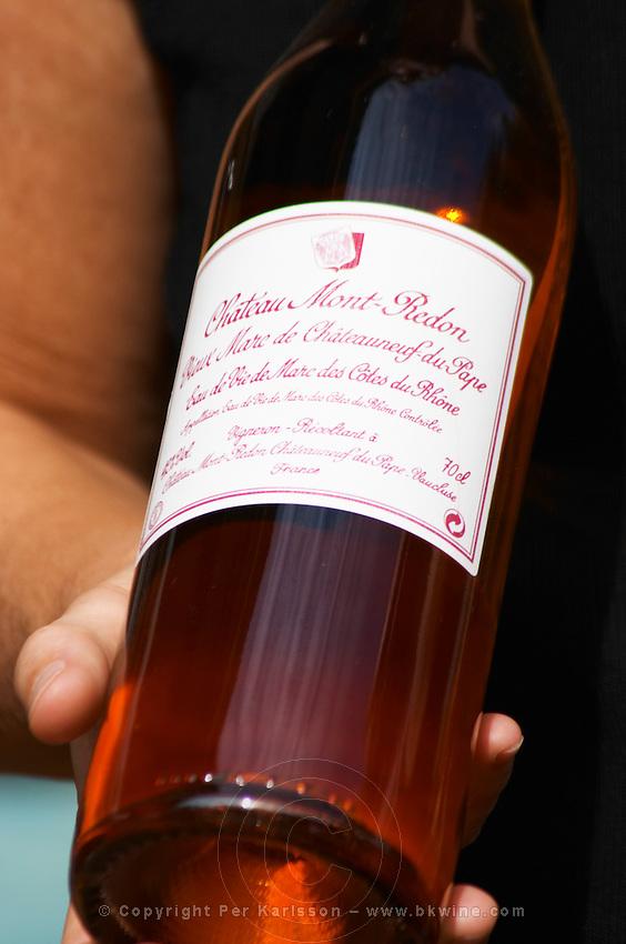 A bottle of Chateau Mont Redon Vieux Marc de Chateauneuf, eau de vie de marc des cotes du Rhone. Spirit made from chateauneuf wine press residues. The restaurant Le Verger de Papes in Chateauneuf-du-Pape Vaucluse, Provence, France, Europe