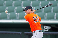 Delmarva Shorebirds pitching coach Troy Mattes #20 hits ground balls during batting practice prior to the game against the Kannapolis Intimidators at Fieldcrest Cannon Stadium on May 20, 2011 in Kannapolis, North Carolina.   Photo by Brian Westerholt / Four Seam Images