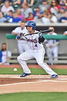Tennessee Smokies shortstop Andrew Ely (4) attempts to lay down a bunt during a game against the Mississippi Braves at Smokies Stadium on April 12, 2017 in Kodak, Tennessee. The Braves defeated the Smokies 6-2. (Tony Farlow/Four Seam Images)