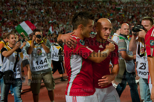 Photographers take pictures of the members of team Hungary celebrating their victory during the UEFA EURO 2012 Group E qualifier Hungary playing against Sweden in Budapest, Hungary on September 02, 2011. ATTILA VOLGYI