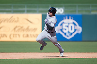 Salt River Rafters right fielder Sam Hilliard (14), of the Colorado Rockies organization, hustles towards third base during an Arizona Fall League game against the Surprise Saguaros on October 9, 2018 at Surprise Stadium in Surprise, Arizona. The Rafters defeated the Saguaros 10-8. (Zachary Lucy/Four Seam Images)