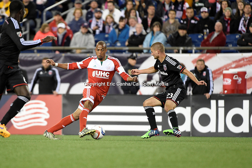 May 23, 2015 - Foxborough, Massachusetts, U.S. - New England Revolution forward Teal Bunbury (10) tries to work the ball by D.C. United midfielder Perry Kitchen (23)during the MLS game between DC United and the New England Revolution held at Gillette Stadium in Foxborough Massachusetts. The New England Revolution and D.C. United ended the game tied 1-1.  Eric Canha/CSM