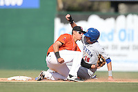 Angel Rosa (3) of the Inland Empire 66ers takes the throw as Tyler Marincov (18) of the Stockton Ports slides into second base during a game at The Hanger on April 11, 2015 in Lancaster, California. San Jose defeated Lancaster, 8-3. (Larry Goren/Four Seam Images)