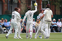 Gareth Batty of Surrey is congratulated by his team mates after taking the wicket of Daniel Lawrence during Surrey CCC vs Essex CCC, Specsavers County Championship Division 1 Cricket at Guildford CC, The Sports Ground on 10th June 2017