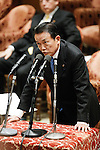 February 12, 2013, Tokyo, Japan - Japan's Finance Minister Taro Aso answers questrions asked by Shintaro Ishihara of the opposition Japan Restoration Party during a question-and-answer session of the Diet lower house Budget Committee in Tokyo on Tuesday, February 12, 2013. (Photo by AFLO)
