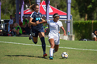 Sanford, FL - Saturday Oct. 14, 2017:  A Pride player is pressured during a US Soccer Girls' Development Academy match between Orlando Pride and NC Courage at Seminole Soccer Complex. The Courage defeated the Pride 3-1.