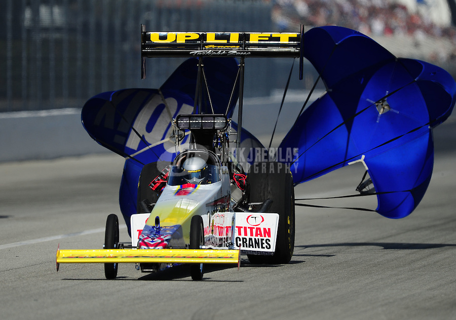 Nov. 11, 2011; Pomona, CA, USA; NHRA top fuel dragster driver Damien Harris during qualifying at the Auto Club Finals at Auto Club Raceway at Pomona. Mandatory Credit: Mark J. Rebilas-.