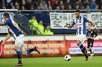 VOETBAL: HEERENVEEN: 23-10-2016, SC Heerenveen - Heracles, uitslag 3-1, Jeremiah St. Juste aan de bal op 1 voetbalschoen, ©foto Martin de Jong