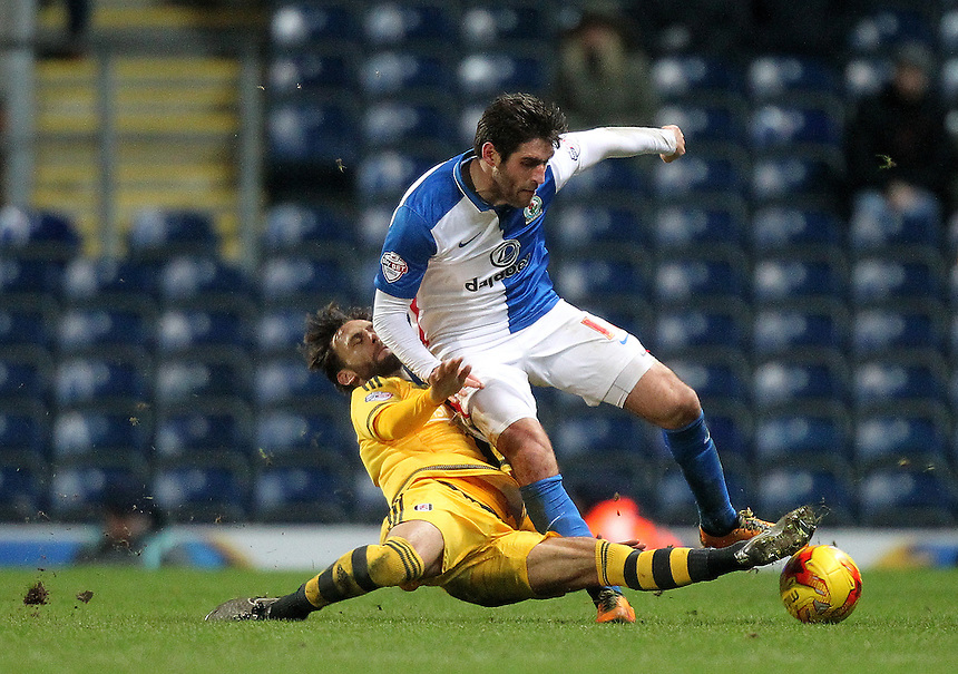 Blackburn Rovers Danny Graham battles with  Fulham's Michael Madi<br />