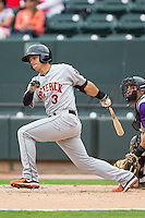 Adrian Marin (3) of the Frederick Keys follows through on his swing against the Winston-Salem Dash at BB&T Ballpark on May 18, 2014 in Winston-Salem, North Carolina.  The Dash defeated the Keys 7-6.  (Brian Westerholt/Four Seam Images)