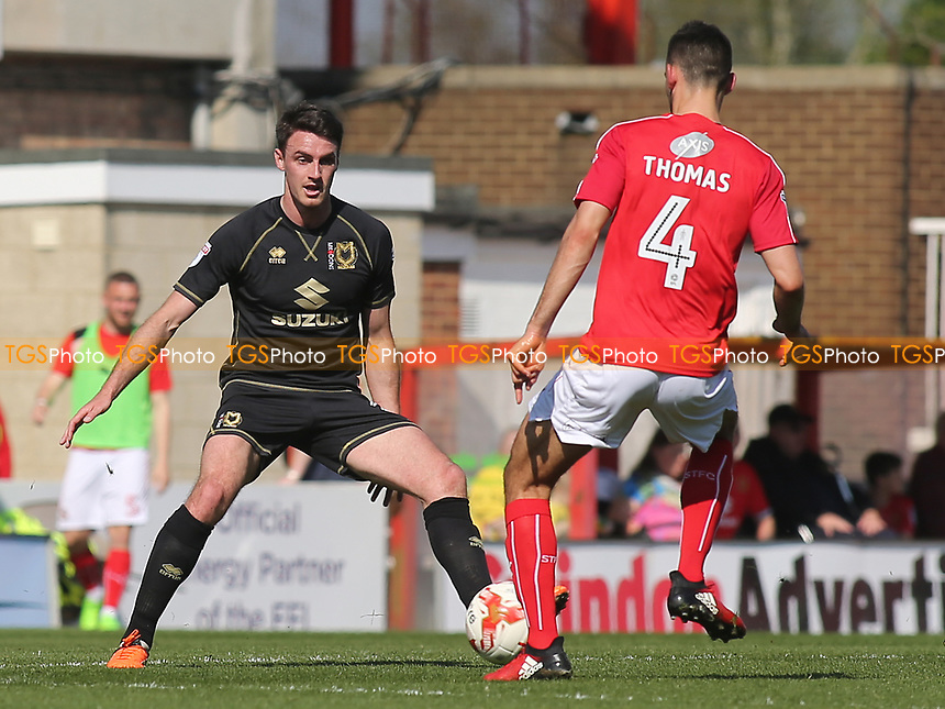 Darren Potter of MK Dons and Swindon's Conor Thomas during Swindon Town vs MK Dons, Sky Bet EFL League 1 Football at the County Ground on 8th April 2017