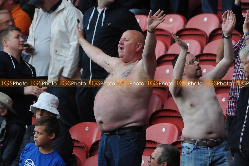 A Sheffield Wednesday fan takes his shirt off to celebrate Atdhe Nuhiu of Sheffield Wednesday's goal - Middlesbrough vs Sheffield Wednesday - Sky Bet Championship Football at the Riverside Stadium, Middlesbrough - 23/08/14 - MANDATORY CREDIT: Steven White/TGSPHOTO - Self billing applies where appropriate - contact@tgsphoto.co.uk - NO UNPAID USE