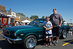 Bob Richhart and his son Koby with his 1966 Mustang during the Hot August Nights Pre-Kickoff show and shine held at the Bonanza Casino in Reno, Nevada on Sunday, August 4, 2013.