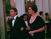 Julia Roberts and a guest arrive as United States President Barack Obama and First Lady Michelle Obama host the 2010 Kennedy Center Honorees to a reception in the East Room of the White House before going to the Kennedy Center.  The recipients for the 33rd annual awards are singer and songwriter Merle Haggard; composer and lyricist Jerry Herman; dancer, choreographer and director Bill T. Jones; songwriter and musician Paul McCartney; and producer, television host and actress Oprah Winfrey.  .Credit: Gary Fabiano / Pool via CNP